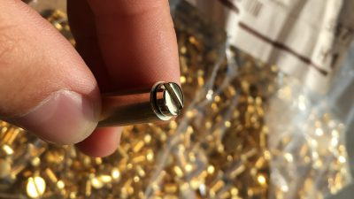 Polished brass bolt